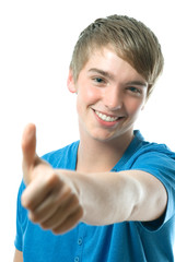 casual teenager holds one thumb up. Smiling