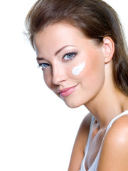 woman with moisturizer cosmetic cream on face