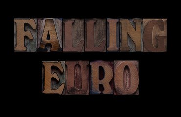 the words falling euro in old letterpress wood type