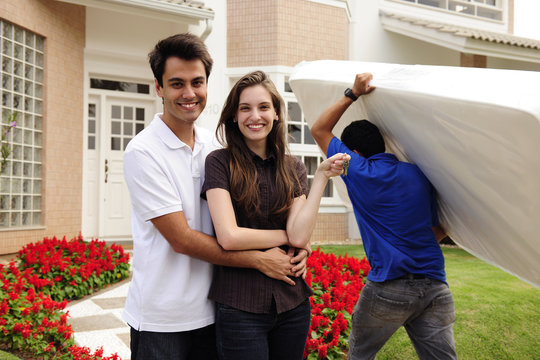 Moving home: Couple infront of new house