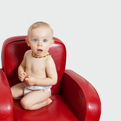 Baby girl on an armchair.bis