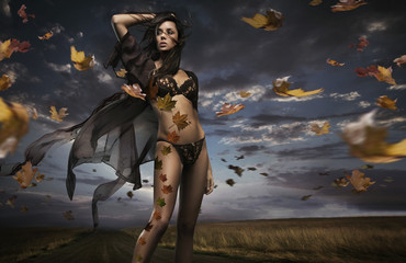 Fine art photo of a beauty lady in the autumn scenery