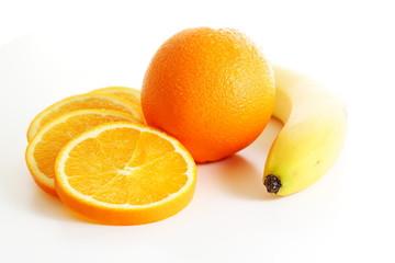 Spoed Foto op Canvas Plakjes fruit Orange mit Orangenscheiben und Banane