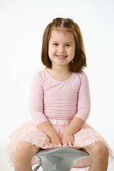 Little girl sitting on chair