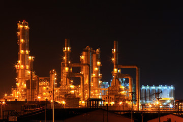 scenic of petrochemical oil refinery plant at night, closeup