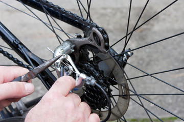 Adjusting Bicycle Gears with Pliers and Key