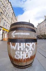 A sign on a whisky barrel, Edinburgh's famous Royal Mile.