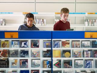 Door stickers Music store two guys listening music in cd store