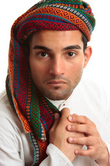 Mixed race middle eastern man wearing turban robe