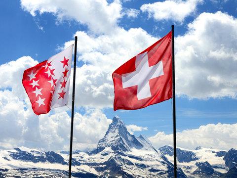 swiss flags in front of Matterhorn