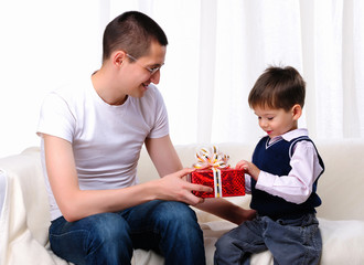 Dad gives his son a gift