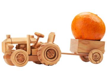 Toy tractor with orange pumpkin.