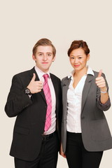 Professional business couple make thumbs up sign