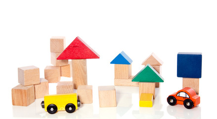 wooden play blocks and cars isolated on white background