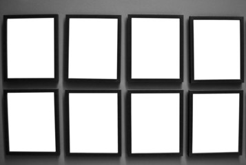 Empty photo frames on wall