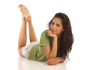 Portrait of cute young girl laying down