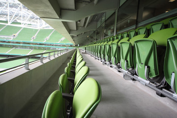 Spoed Fotobehang Stadion Many rows of folding seats in empty stadium