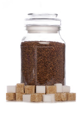 Jar of coffee with white and brown sugar
