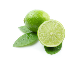 Green lemon with leaves on white background
