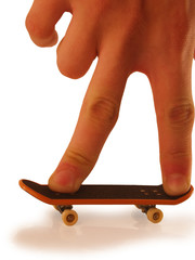 Riding on a miniature toy skateboard.