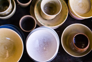 A collection of Japanese ceramic bowls and cups from above