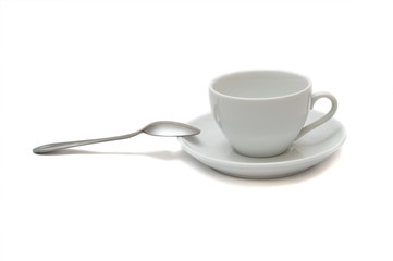 white cup with spoon and saucer isolated on white
