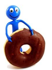 Ben d'Man diving into a chocolate doughnut