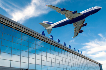 The modern russian airport with airplane over it