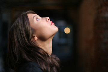 Woman looking up in faith, dreaming a dream