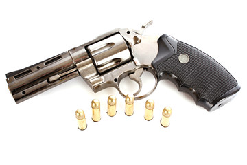 Bullets and revolver. Not real gun (lighter)