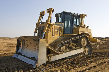 Bulldozer with a clear blue sky