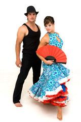 young dancing couple posing and female holding red chinese fan