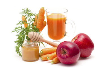 glass of fresh carrots juice with apple and honey