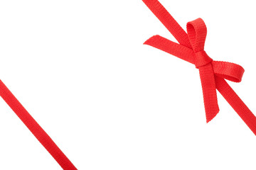 Red ribbon with a bow isolated on white background
