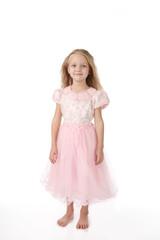 little girl in a pink elegant dress.White background
