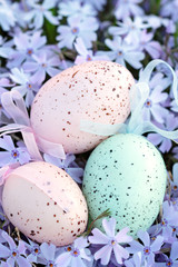 Beautifully decorated Easter eggs lying in a bed of phlox.