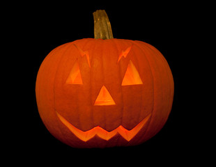 scary halloween pumpkin with face over black background