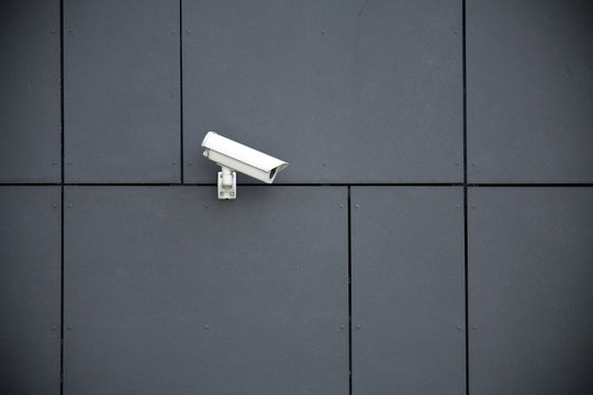 Security camera on office building, safety concept