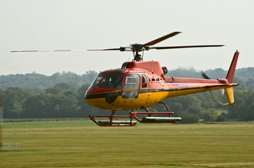 AS.350 helicopter hovers before landing