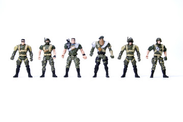 Collection of toy soldiers  over white background