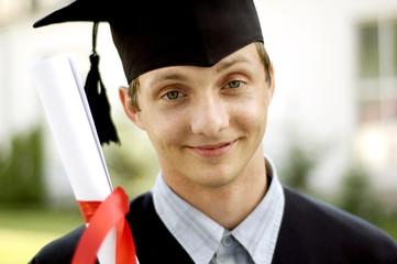 graduate looks into the camera
