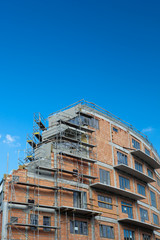 residential building construction site on a lovely summer day (c