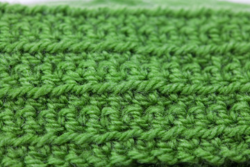 Skein of wool and knitted piece  background