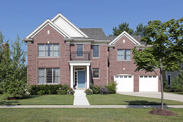 Brick home with white columns