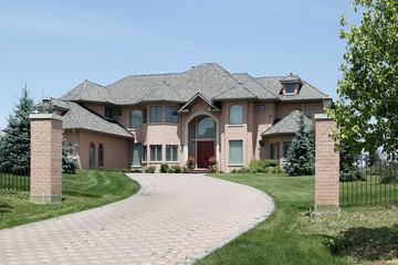 Luxury brick home with pillars