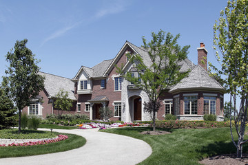 Large brick home with stone entry