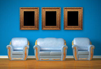 Two blue chairs with couch and picture frames