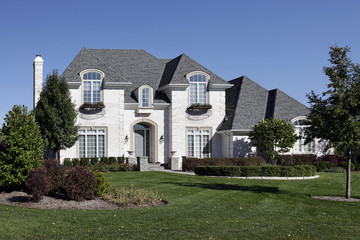 White brick home with arched entry