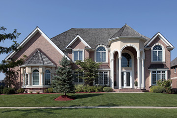 Large brick home with columned entryway