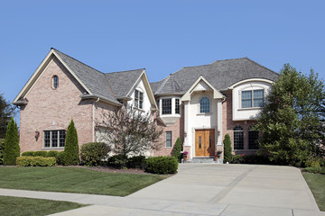 Large home with arched entry